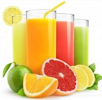 four-glasses-of-fruit-juice-near-fruit